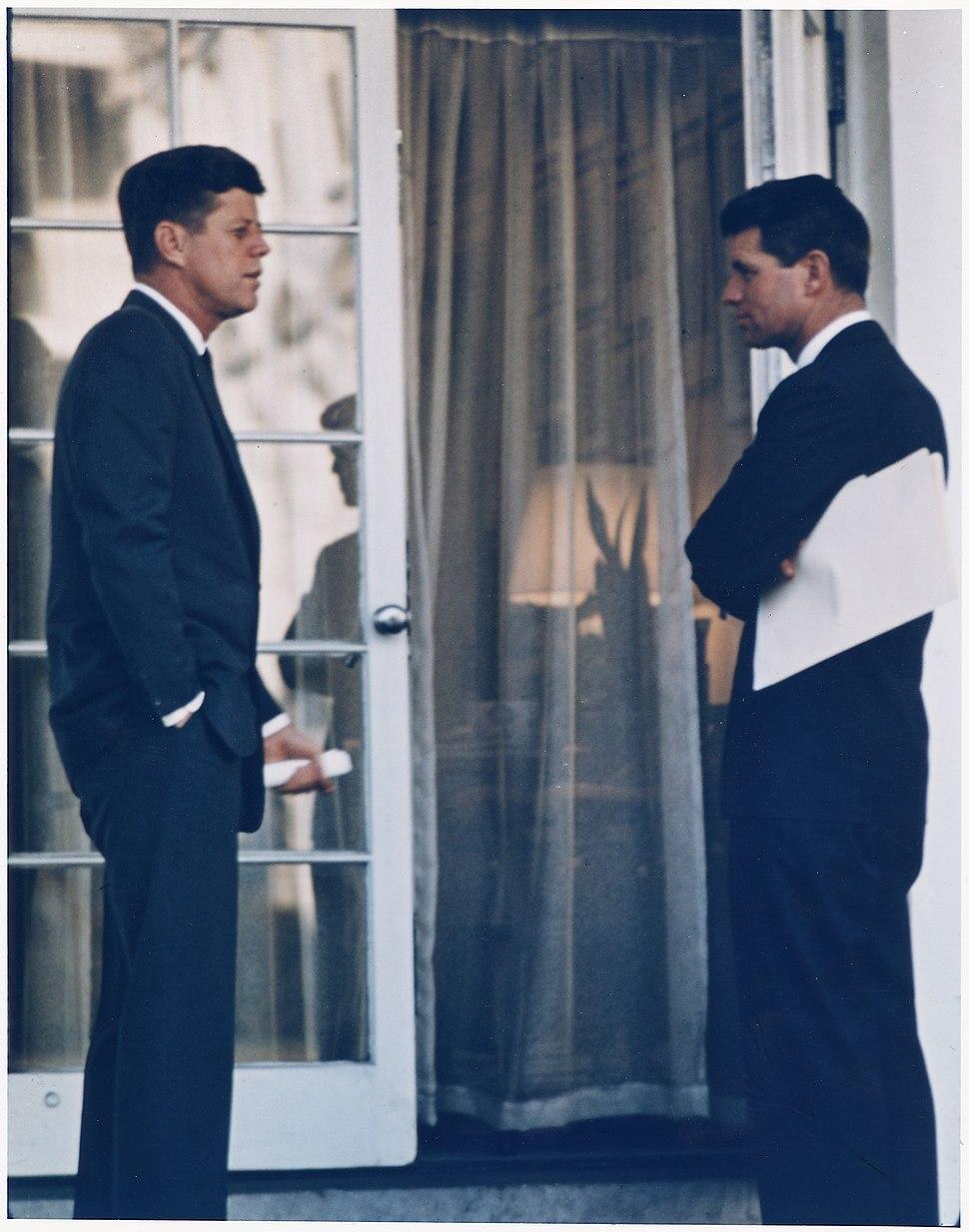 President with Attorney General. President Kennedy, Attorney General Kennedy. White House, Oval Office Doorway. - NARA - 194221