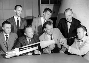 Gus Grissom - The Project Mercury astronauts with a model of an Atlas rocket, July 12, 1962 – Grissom is at the far left.