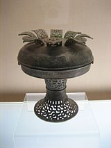 Chinese pu vessel with interlaced dragon design, Spring and Autumn Period (722 BC-481 BC).