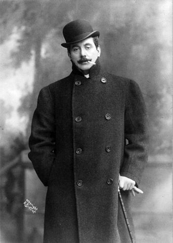 Puccini standing, facing slightly left; wearin...