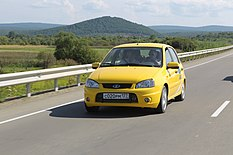 Putin drives a yellow Lada through the Amur Highway 1.jpeg