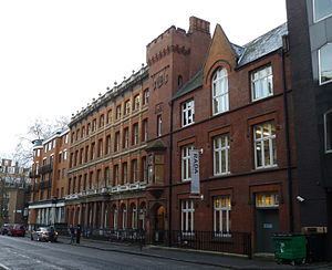 Bloomsbury Rifles - The Drill Hall, Chenies Street (the darker red brick building on the right with the mock-medieval tower), is now the Royal Academy of Dramatic Arts Studios.