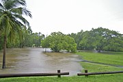 Flooding of a creek due to heavy monsoonal rain and high tide in Darwin, Northern Territory, Australia
