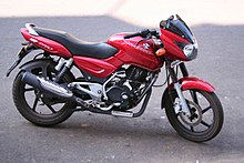 Red Bajaj Pulsar outside hotel in Goa.jpg
