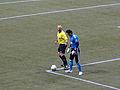 Refereen Jasen Anno and goalkeeper Joe Cannon.jpg