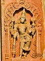 Relief of deity holding attributes and blessing devotees in Aghoreshwara temple at Ikkeri.jpg