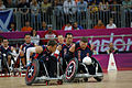 Retired U.S. Sailor William Groulx, center, the U.S. wheelchair rugby team captain, trails two teammates as they go through warm-up drills to prepare for a rugby match versus Great Britain at the Paralympic 120905-A-SR101-2243.jpg