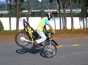 Weight transfer - A motorcyclist performing a stoppie.