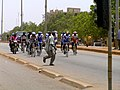 Runner in front of racing cyclists in Burkina Faso, 2009.jpg