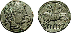 Ancient Iberian coinage - O: Male head right, with dolphin and 'S'.