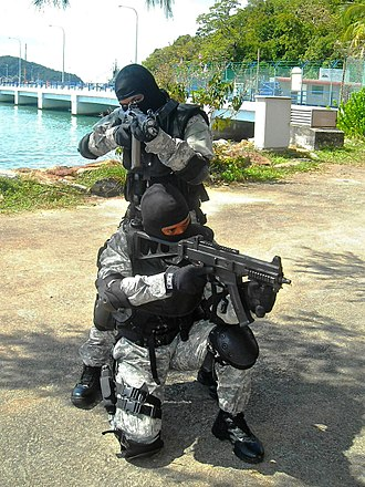 Heckler & Koch UMP - Malaysian Maritime Enforcement Agency officers armed with the UMP9 and SG 553.