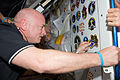 STS-134 Mark Kelly attaches a mission patch decal.jpg