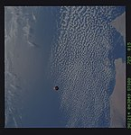 STS088-725-015 - STS-088 - SAC-A satellite in orbit over the Earth.jpg