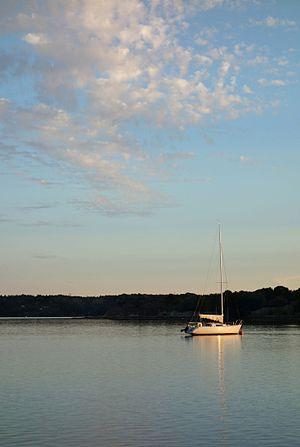Sailboat at sunset in Brofjorden