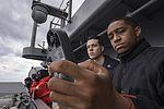 Sailor measures wind speed aboard USS Dwight D. Eisenhower. (27422693812).jpg