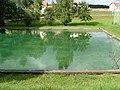 Schwimmbad,es wird mit dem Wasser der Günzquelle gefüllt. - panoramio.jpg