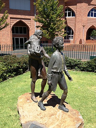 """Education in Victoria - The """"Mother and Son"""" sculpture at Scotch College, Melbourne, which celebrates the role of mothers in the boys' lives and education"""