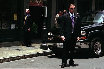Secret Service agents stand guard outside of t...