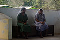 Sister Jenny (L) and Sister Ruth ® sitting on a bench at the Christian Care Centre. (10721442424).jpg