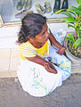 Sitting begging woman Sri Lanka disabled.jpg