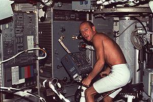 Skylab 2 Conrad using bicycle ergometer.jpg