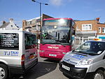 Southern Vectis 594 R812 NUD and Cowes Co-op parked taxis.JPG