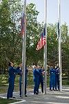 Soyuz MS-06 crew members with their backups raise flags.jpg
