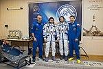 Soyuz MS-10 crew with backup crew at the Baikonur Cosmodrome.jpg