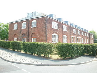Barracks - Cavalry barracks, Christchurch, Dorset, 1795: officers' accommodation in the end blocks, ground-floor stables with men's accommodation over.