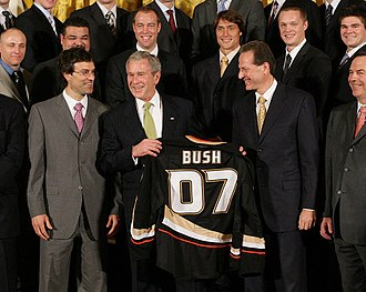 Anaheim Ducks - U.S. President George W. Bush is presented with a Ducks jersey during a White House ceremony in honor of the team's championship season.