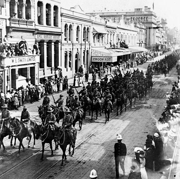 Mounted troop parading down Queen Street