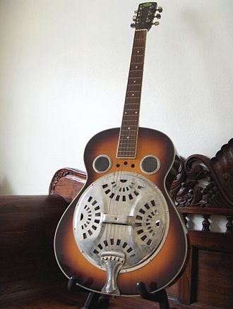 Dobro - Resonator guitar with single inverted resonator.