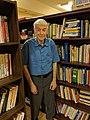 Stephen Barrett standing with books 1.jpg