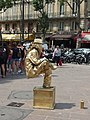 Street performer, Place Saint-Michel, Paris July 2014.jpg