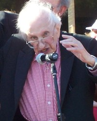 Terkel speaking into a microphone