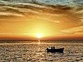 Sunset i Sri Lanka seen from ocean - little boat.jpg