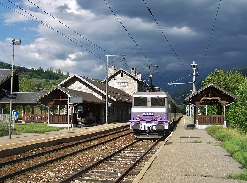 General sight on tracks, platforms and building of Aime - La Plagne railway station, in the Tarentaise valley (Alps), Savoie, France.