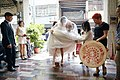 Taiwanese brides stepping over the brazier.jpg