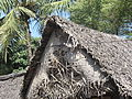 Thatched hut with coconut-leaves mat.JPG