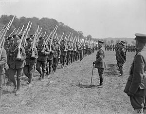 Northamptonshire Regiment - Troops of the 1st Battalion, Northamptonshire Regiment marching past Prince Arthur, the Duke of Connaught, at his inspection of the 2nd Brigade, near Bruay, 1 July 1918.