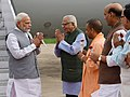 The Prime Minister, Shri Narendra Modi being welcomed by the Governor of Uttar Pradesh, Shri Ram Naik, the Chief Minister of Uttar Pradesh, Yogi Adityanath and other dignitaries, on his arrival, in Lucknow, Uttar Pradesh.JPG