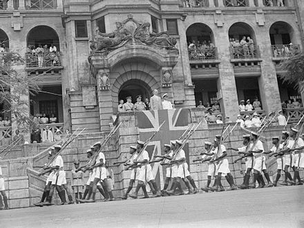 African Naval ratings march past the Governor of Sierra Leone, Hubert Stevenson. The Royal Navy during the Second World War A24465.jpg