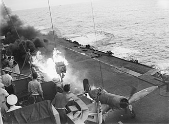 British Pacific Fleet - An FAA Corsair's auxiliary petrol tank bursts into flames, while making an emergency landing on board HMS Victorious.