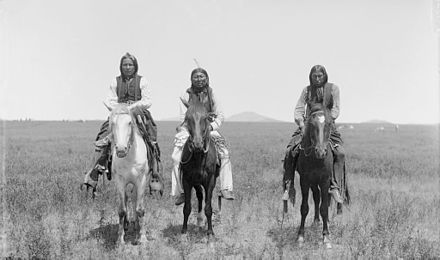 Three mounted Comanche warriors, left, Frank Moetah. Photo by James Mooney, 1892. Three mounted Comanche warriors - 1892.jpg