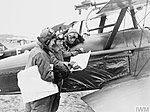 Three pilots of No. 1 Squadron, RFC, studying maps by an S.E.5a at Clairmarais aerodrome.jpg