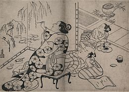 Torii Kiyonobu - Courtesan painting a screen.jpg