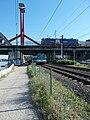 Train Hungary locomotive on the Southern Railway bridge and BHÉV MXA, 2018 Ferencváros.jpg