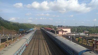 Trains await a crossing at the Thivim Railway Station in Goa, India. 3.jpg
