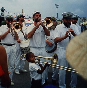 Trombone Shorty - Trombone Shorty at age five, with the Carlsberg Brass Band, New Orleans Jazz & Heritage Festival, 1991