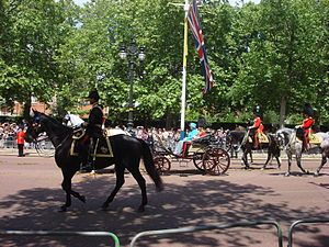 Crown Equerry - The Crown Equerry (left, on horseback) escorts The Queen when carriages are used in procession.